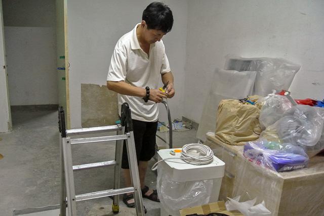 建物管理のおじさん@北京